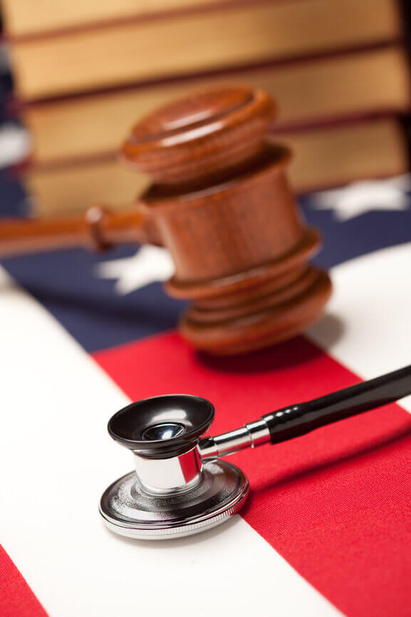 American flag, stethoscope, and court gavel image graphic